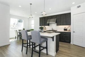Gourmet kitchens with huge islands are one of the standard features in these popular homes in the San Fernando Valley.