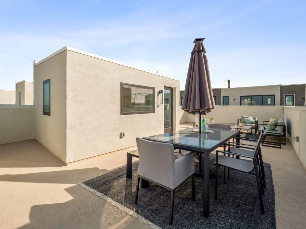 San Pedro new home features spacious roof deck.